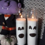 Dollar Store Candles Turned Halloween Ghost Decoration